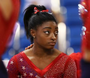 The International Gymnastics Federation prohibits heavy makeup for competitions