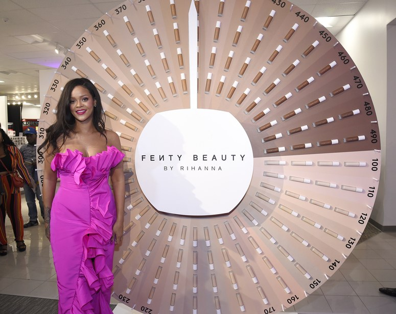 Rihanna attends Fody Beauty Event at Sephora Standing in front of the foundation